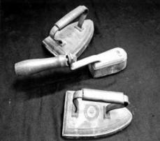 Artifacts in CHSNE's archives collection include hand irons used in early Chinese laundries such as those pictured here. (CHSNE collection)